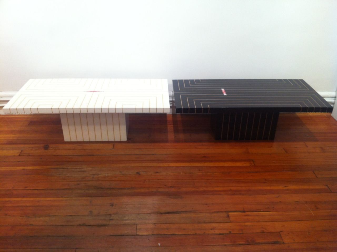 OUR WHITE  PETER DAYTON TABLE  GETS A NEW COMPANION   WE'RE DIGGING THE SURFBOARD-MEETS-ELLSWORTH KELLY VIBE