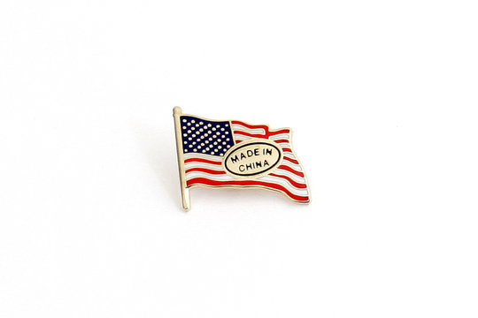 "Happy 4th of July! Celebrate our independence with Derek Brahney's  Dependence Pin . His work is an ""updated, more accurate version"" of the patriotic symbol based on today's global economic climate. Check it out on the  GREY AREA website !"