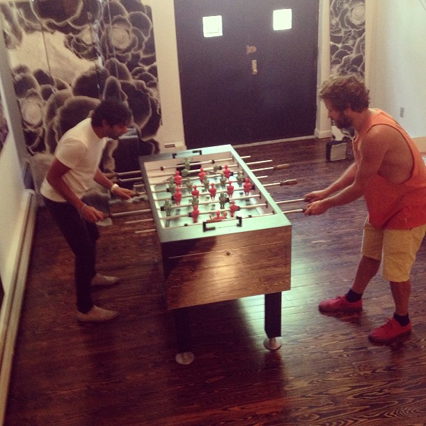 @manishmas and @masteroliverclegg throw down on Clegg's custom foosball table #greyday #oliverclegg