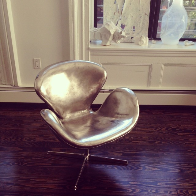 @ekstromstudio's shiny Swan Chair arrives just in time for an afternoon nap #nappingwithart #livingwithart