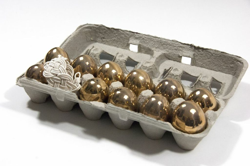 One of these eggs is not like the others.     Golden Eggs  by Rob Wynne and the  Panopea Bracelet  by SerpentSea