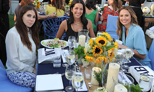 "Style.com caught up with celebrities like Zosia Mamet, Rebecca Minkoff, and Stacy Kiebler (pictured here) enjoying an amazing dinner in the garden at Dustin Yellin  's Pioneer Works space in Red Hook, Brooklyn, which has been newly renovated after sustaining massive damages during Hurricane Sandy. According to Ye  llin, this project is ""sort of an experimental utopia."" The space houses many different kinds of artists, including a physicist, a performance artist, a sculptor, and a painter, making for a very unique exhibition space!  Learn more about Pioneer Work , and don't forget to check out Dustin Yellin's  cool, 3D art pieces  on GREY AREA's website!"