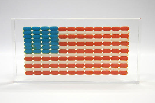"""Americans love their pills! Pill companies love their Americans!"" - Ray Geary Ray Geary's Pill Flag ($595) is the perfect piece of art to adorn any Fourth of July party! Be sure to check out more of Ray's witty and innovative resin encapsulations, such as his Pill Studies and Pill Explosion, which are available at the Guggenheim Museum store and on the GREY AREA website!"