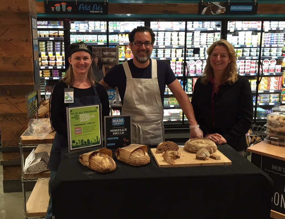 Grantwinner Eduardo of Morell's Bread and Working Solutions Chief Development Officer Laura with Whole Foods Shift Leader Robin at Whole Foods in Berkeley
