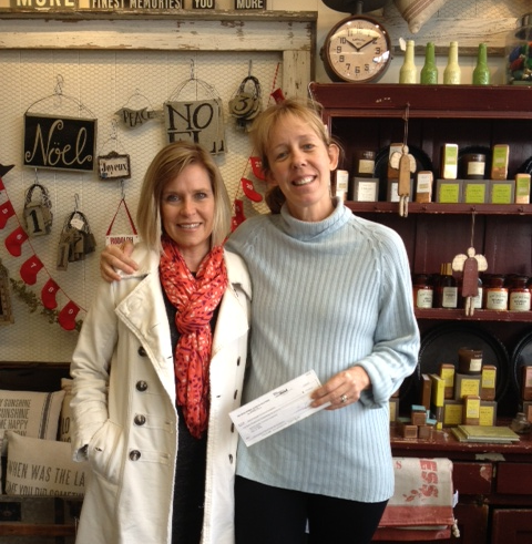 Patricia, owner of the Roost, receives her grant check from Working Solutions Business Development Officer Laurie O'Hara