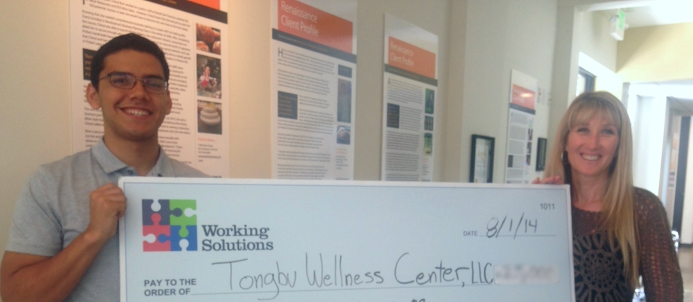 Working Solutions Business Lending Associate Roberto Hernandez with Tongbu Wellness Center Owner Heide Nielsen