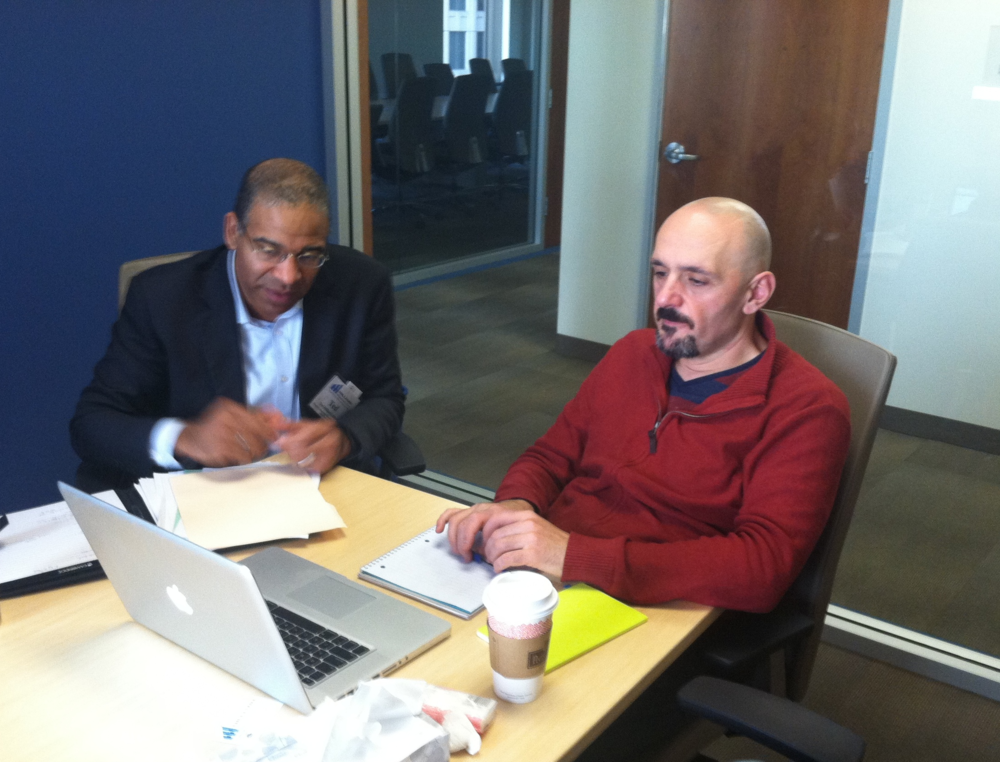 Ted Hilliard of Hilliard Management Group helps Working Solutions Client Ender Markal, owner of Richmond Republic Draught house, set up his Quickbooks Software