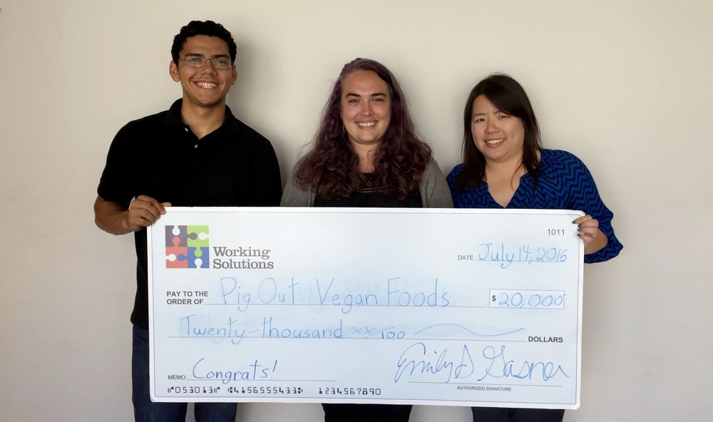 Samantha, owner, receiving her funds from Roberto Hernandez, Business Lending Officer, and Agnes Cheung, Director of Business Lending