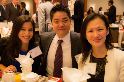 Natalie Wade of Wells Fargo, a Wells Fargo guest, and Henrini Suyono of Wells Fargo