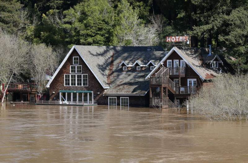 Water from the Russian River surrounds Highland Dell Lodge in Monte Rio on Thursday, February 28, 2019. Photo by Christopher Chung,  The Press Democrat