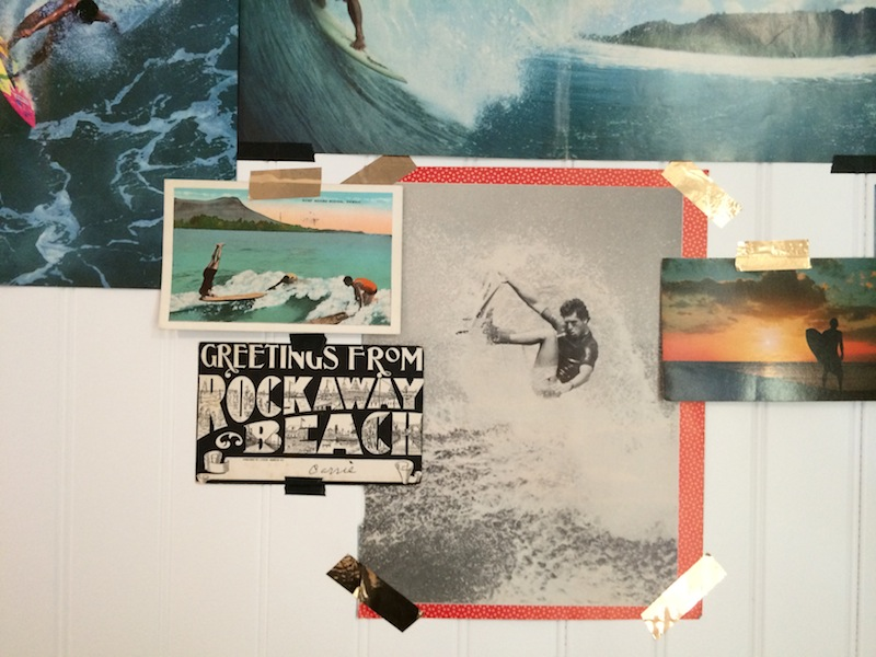 In the kitchen: A detail from the art wall features a vintage Rockaway Beach postcard found on Ebay, and pages taken from 80's surf mags.