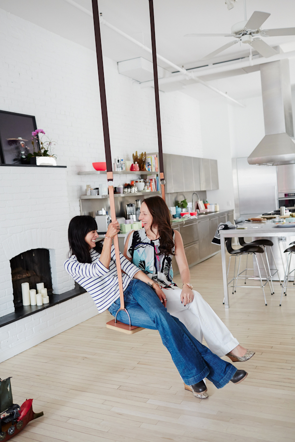 Room for two. Athena Calderone and Elisabeth Holder of Laduree swing inside Holder's mod-Pop home, seen on Eye Swoon.