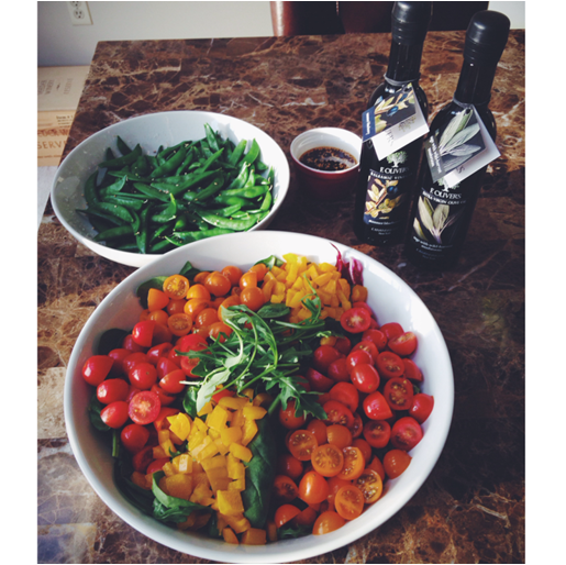 Fresh Arugula salad with grape tomatoes, yellow peppers, and of course F. Oliver's Summer Blueberry Balsamic + Sage Wild-Harvest Mushroom Olive Oil. Delicious!