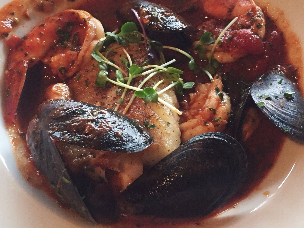 Cioppino aka Fisherman's stew with BostonCod, Mussels, Large Shrimp, Red Wine Tomato Broth served withFocaccia! Great depth of flavor in every spoonful!
