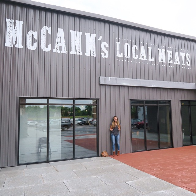 Standing in front of McCann's Local Meats all-in-one butcher shop, deli, and sandwich stop!