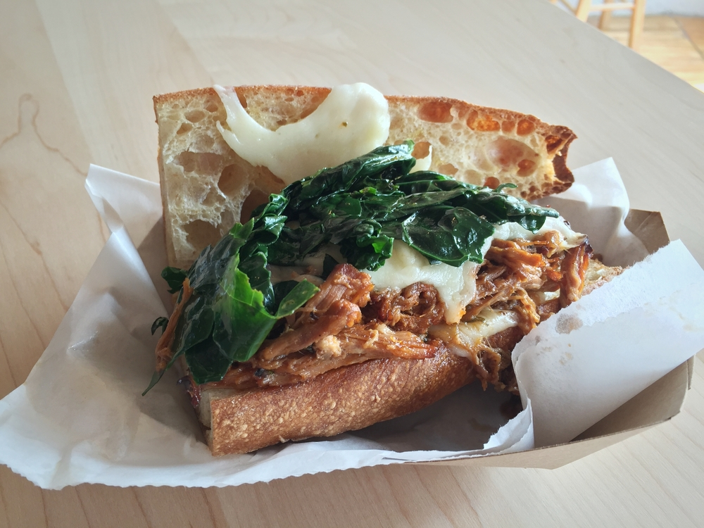 Fiorella's Herb Roasted Pork Shoulder Sandwich with Garlic Greens, Sharp Provolone on a Toasted Baguette $9