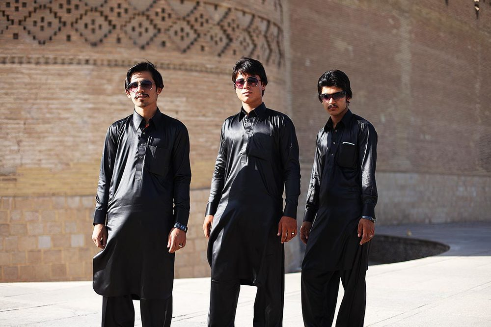 3 youngs balutchis in front of the  Arg-e Karim Khan  in  Shiraz  | IRAN