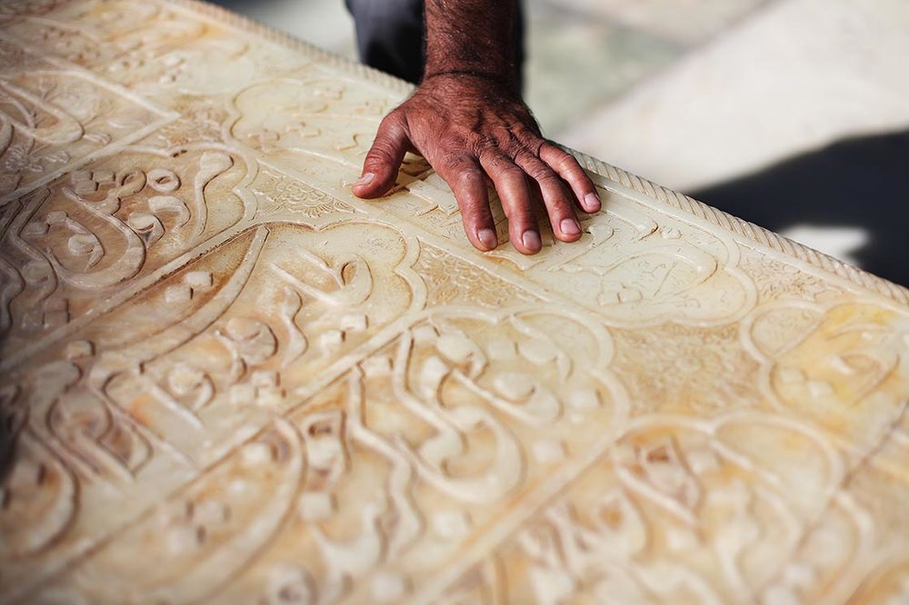 The marble tombstone is engraved with a long verse from the poet. Iranians have a saying that every home must have two things : first the  Quran , then a collection of the works of  Hafez ...