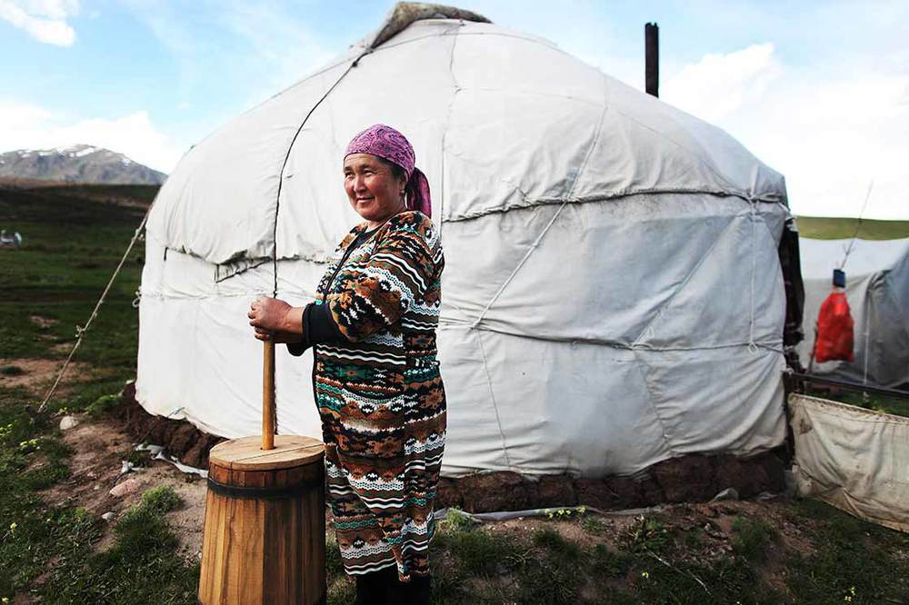 A woman preparing the  Kumis , a fermented dairy product traditionally made from mare's milk. The drink remains important to the peoples of the Central Asian steppes  | KYRGYZSTAN