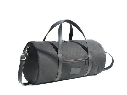 4bfc5384f7 Woolfell — Black cotton canvas and leather barrel bag
