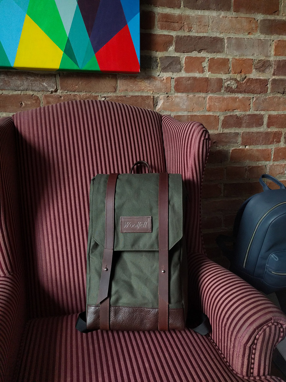 Green 'Warrior' backpack with chocolate brown leather