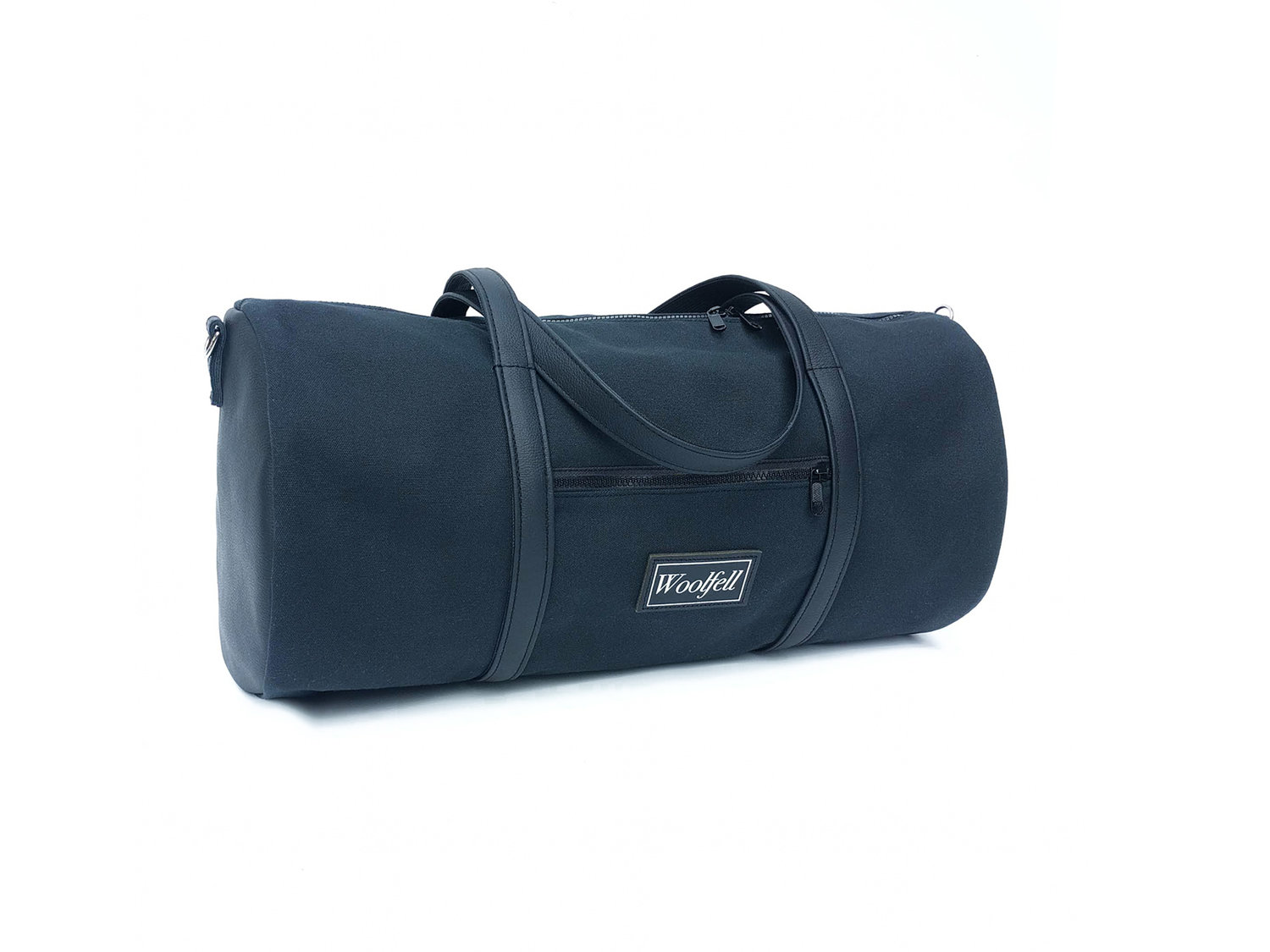 Woolfell — Black cotton canvas and leather barrel bag b474eac10d47a