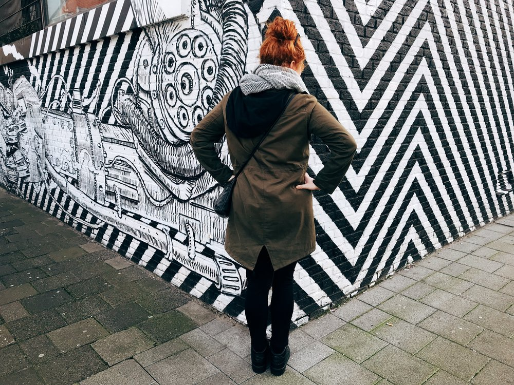 I made her pose in front of graffiti even though she doesn't like photos taken of her. heheheh