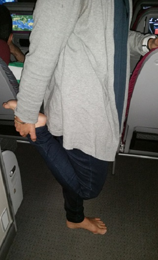 Quadricep stretch on the plane