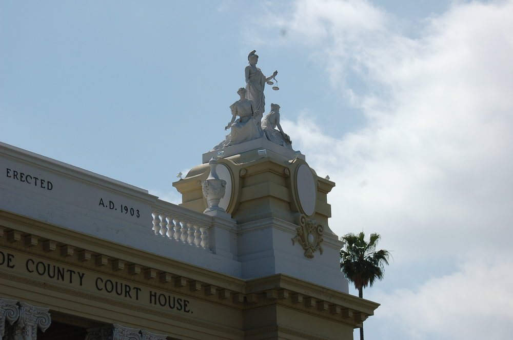 The Historic Riverside County Court House Statues of Lady Justice with her sisters, Law and Truth    Photograph taken March 25, 2017.