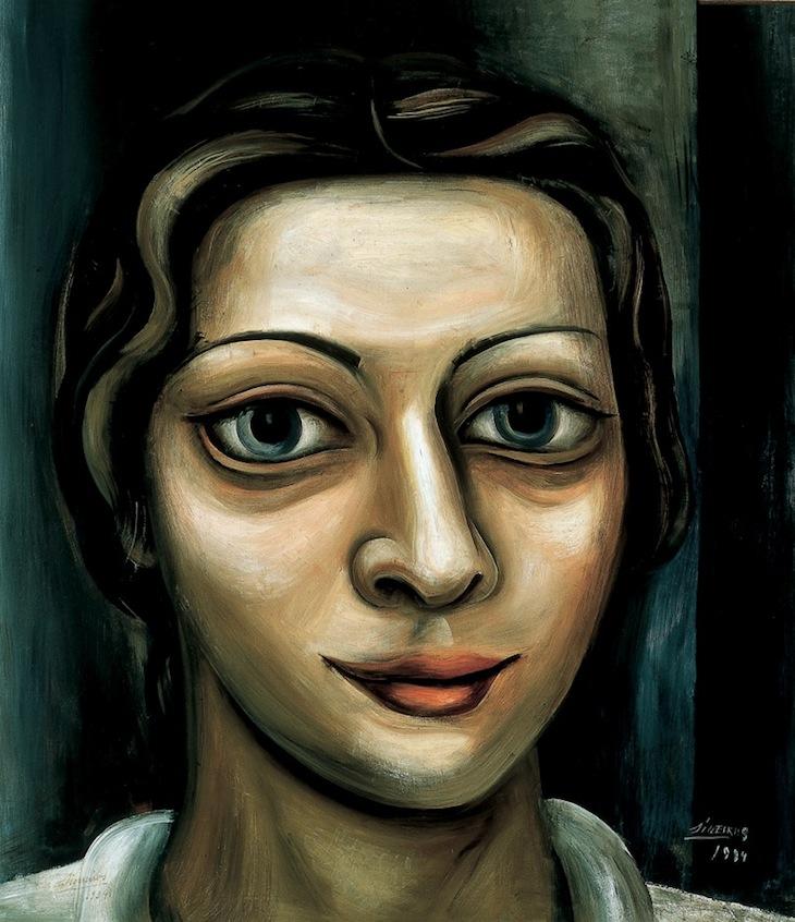 David Alfaro Siqueiros   Retrato de mujer (Eve Mayers) , 1934  Óleo sobre tela  92.3 x 81.5 x 2  En 1934, David Alfaro Siqueiros se encontraba exiliado en Estados Unidos, después de haber estado encarcelado en la Penitenciaría de Lecumberri y viajado por América del Sur. Destaca la amplia producción de una serie de retratos. Éste, dedicado a la bailarina Eve Mayers, adopta un formato que enfatiza los rasgos de la mujer, en mayor medida de los ojos, como en varios de los ejemplos que presentó en ese periodo.
