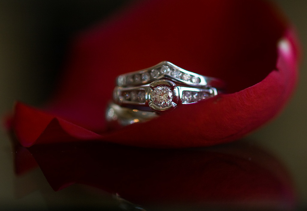 Photograph of wedding rings in rose petal