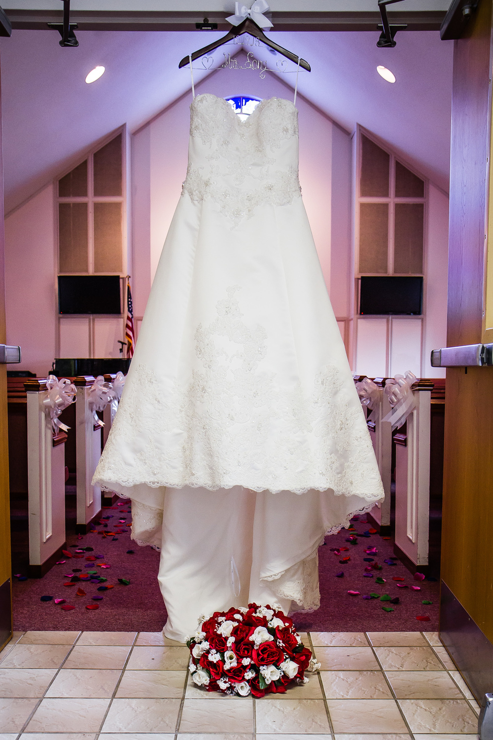 Photograph of a wedding dress and wedding bouquet in church