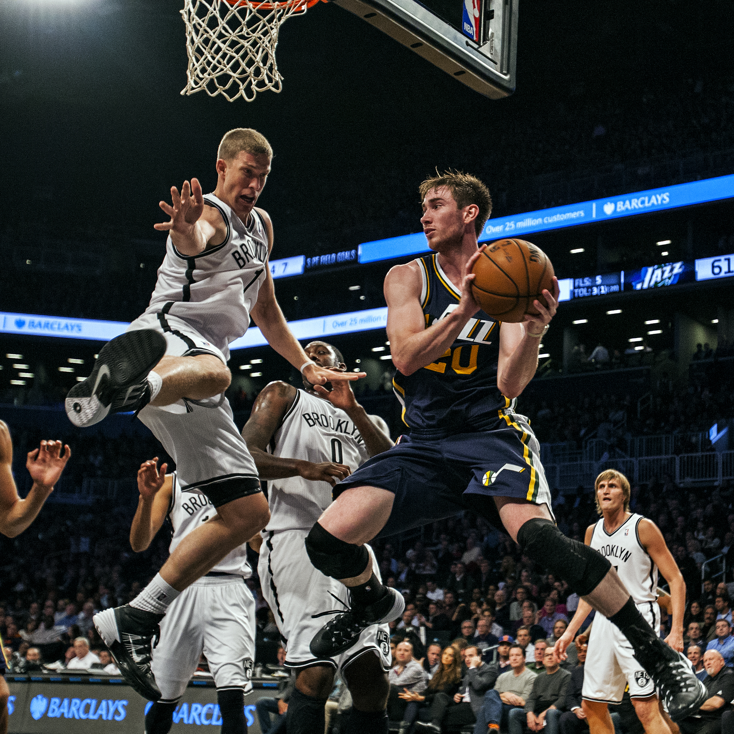 Utah Jazz shooting guard Gordon Hayward (20) inbounds a ball while being pressured by Brooklyn Nets power forward Mason Plumlee (1) during the NBA regular season match played between the teams on Nov. 5, 2013 at Barclays Center in Brooklyn, N.Y.
