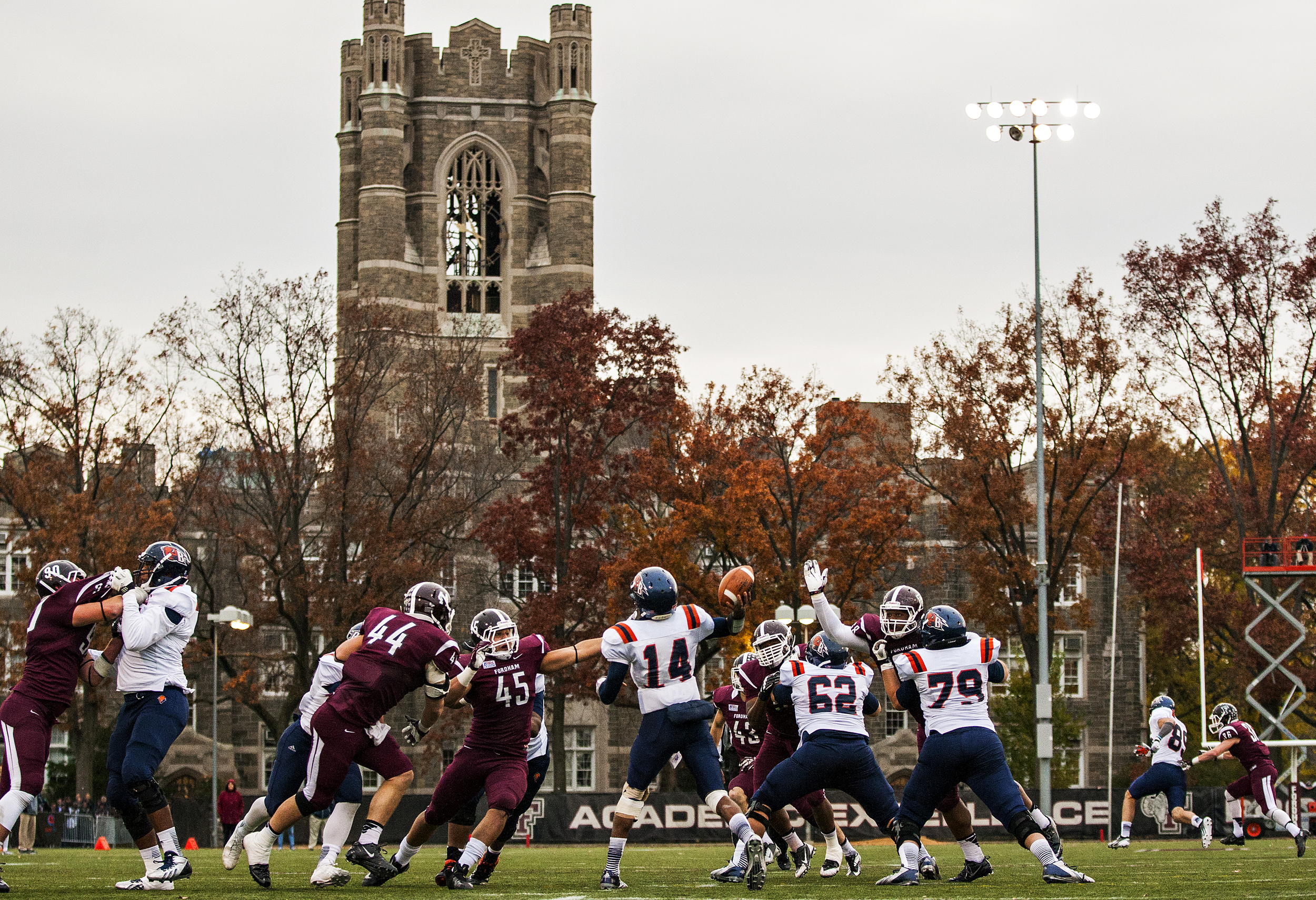 Bucknell quarterback Brandon Wesley (14) throws the ball with Fordham University's Keating Hall in the background during the NCAA FCS football game played between the schools at Jack Coffey Field in Bronx, N.Y. on Nov. 9, 2013.