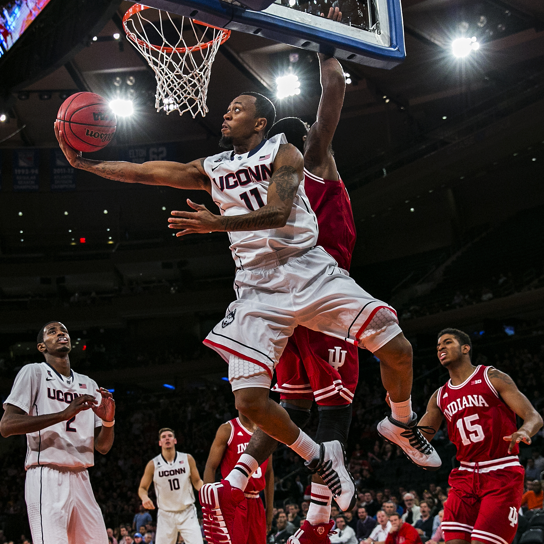 Connecticut guard Ryan Boatright (11) goes for a layup as Indiana forward Jeremy Hollowell (33) misses the block during second half action of the 2K Sports Classic Championship game between the #18 UConn Huskies and the Indiana University Hoosiers on Nov. 22, 2013 at the Madison Square Garden in New York, N.Y. UConn won the game 59-58.