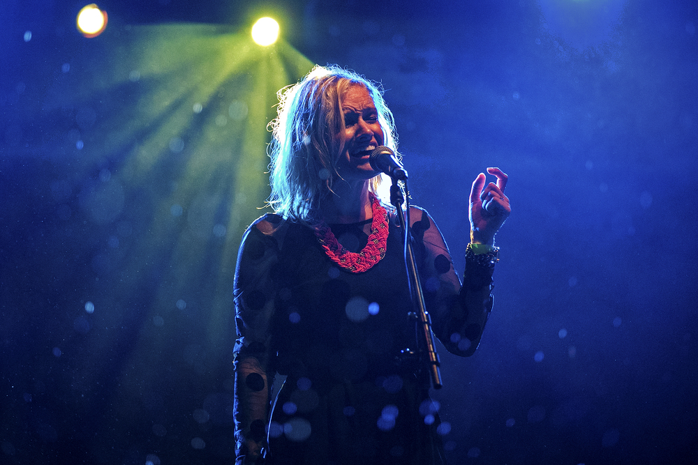 April Rankin of The Rankin Twins sings under the pouring rain during an iHeartRadio-sponsored show at The Belmont in Austin, Texas on July 15, 2014.