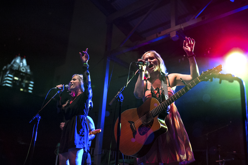 Texas natives April and Amy Rankin of The Rankin Twins play during an iHeartRadio-sponsored show at The Belmont in Austin, Texas on July 15, 2014.