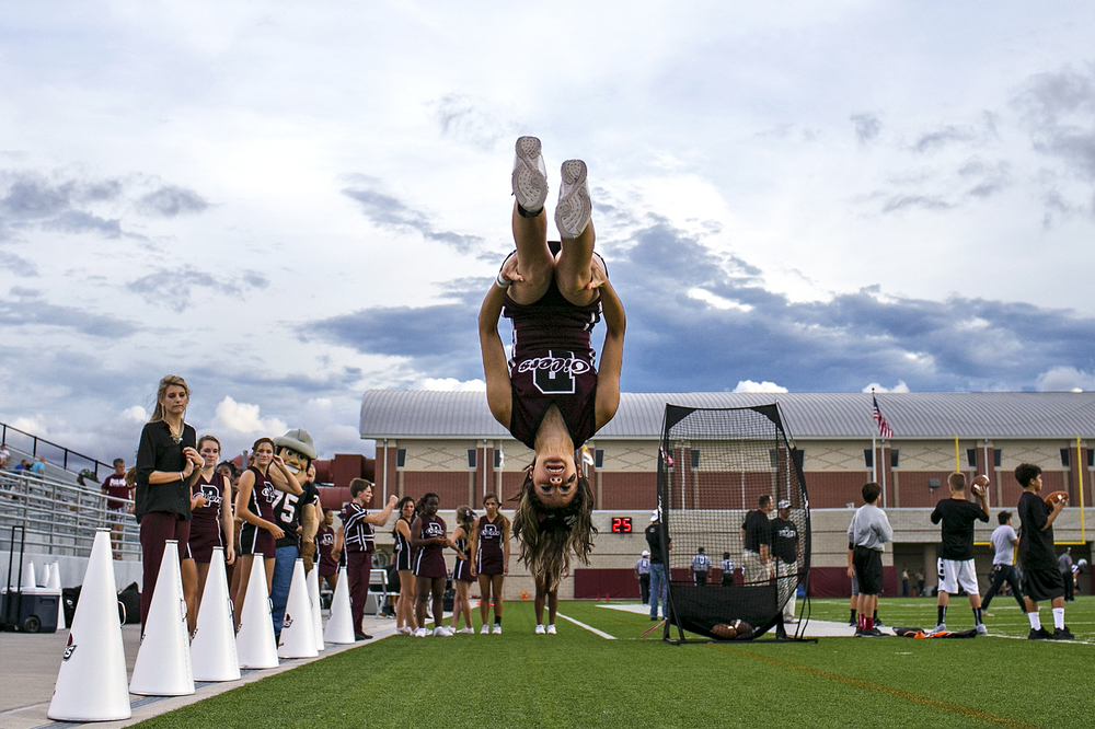 Pearland cheerleaders practice prior to the Oilers' opening game of the 2014 Texas high school football season against  Conroe Woodlands College Park played on August 29, 2014 at Woodforest Bank Stadium in Shenandoah, Texas. The Oilers would go on to defeat the Cavaliers 25-14.