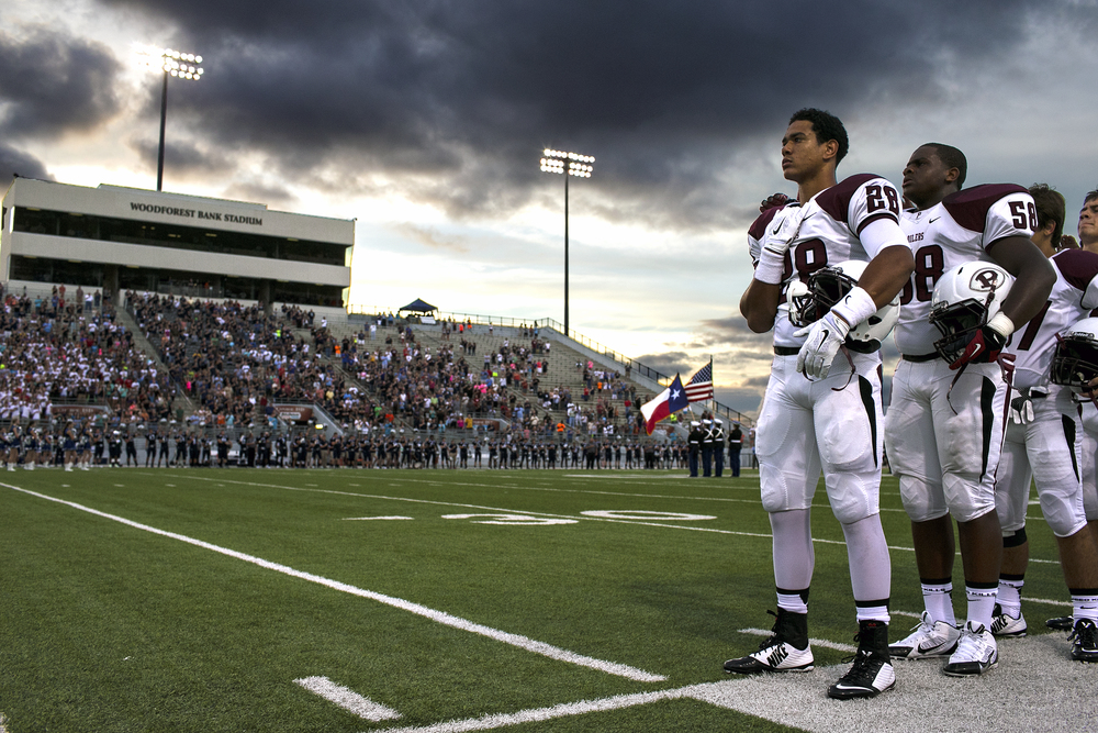 Pearland defensive back Matt La Chiusa and his teammates stand during the playing of the National Anthem before the Oilers' opening game of the 2014 Texas high school football season against the Conroe Woodlands College Park Cavaliers played on August 29, 2014 at Woodforest Bank Stadium in Shenandoah, Texas. Pearland would go on to win the contest 25-14.