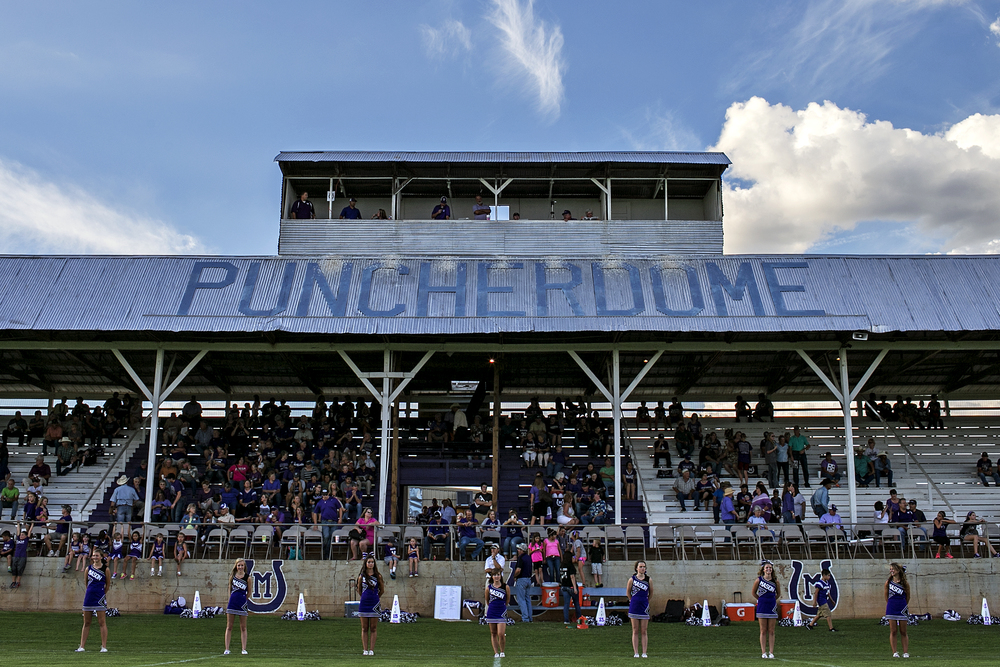 "Mason Punchers' cheerleaders line up in front of the home crowd stands prior to Mason's Week 2 game against De Leon on September 5, 2014 at R. Clinton Schulze Stadium in Mason, Texas. Better known as ""The Puncher Dome,"" Schulze Stadium was built in 1938 and was originally used as a horse racing venue."