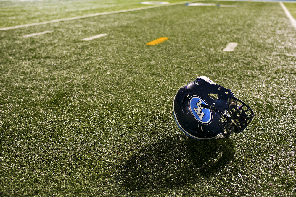 A Raider helmet lies on the turf after being discarded by a frustrated owner following the Raiders' 14 - 40 loss to the Sabine Cardinals on September 12, 2014 at Bruce Bradshaw Stadium in New London, Texas. After almost 100 years of the New London school explosion, the Raiders and West Rusk High School still find ways to pay tribute to those who lost their lives on March 18, 1937. On the new turf at Bruce Bradshaw Stadium, the 37-yard line tickers were painted gold at the request of the Raiders coaching staff, honoring both the year of the tragedy and the London School's original team color.