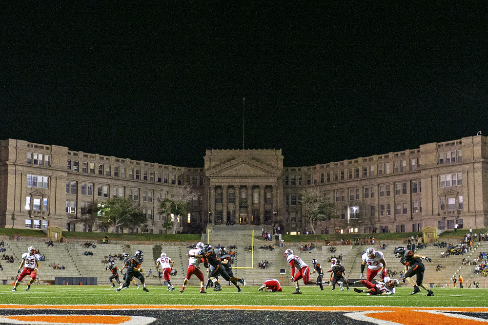 El Paso High senior linebacker Rodolfo Payan (42) sacks Jefferson Silva High School junior quarterback Jan Amato during fourth quarter action of the week 4 game played between the schools on September 19, 2014 at R. R. Jones Stadium in El Paso, Texas. R. R. Jones Stadium is overlooked by the Classical Revival architecture of El Paso High School, highlighted by the six towering pillars making up its Corinthian porch at the main entrance to the school.