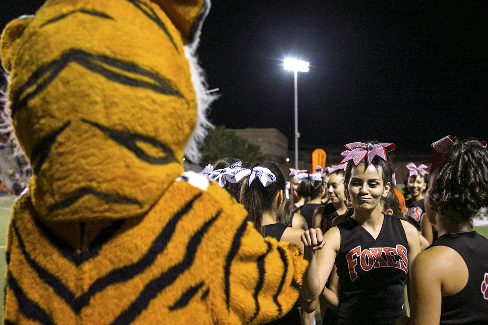 The El Paso High School Tiger mascot fist bumps Jefferson Silva High School cheerleaders during fourth quarter action of the Tigers and Silver Foxes football game played on September 19, 2014 at R. R. Jones Stadium in El Paso, Texas. El Paso High School is now undergoing preparations for its centennial celebration to be held during the 2015-2016 school year. The Tigers' hope is that its football team can continue its recent improvement under coach Robert Morales, who helped the Tigers break a streak of 10 consecutive losing seasons, and add another reason to celebrate next year.