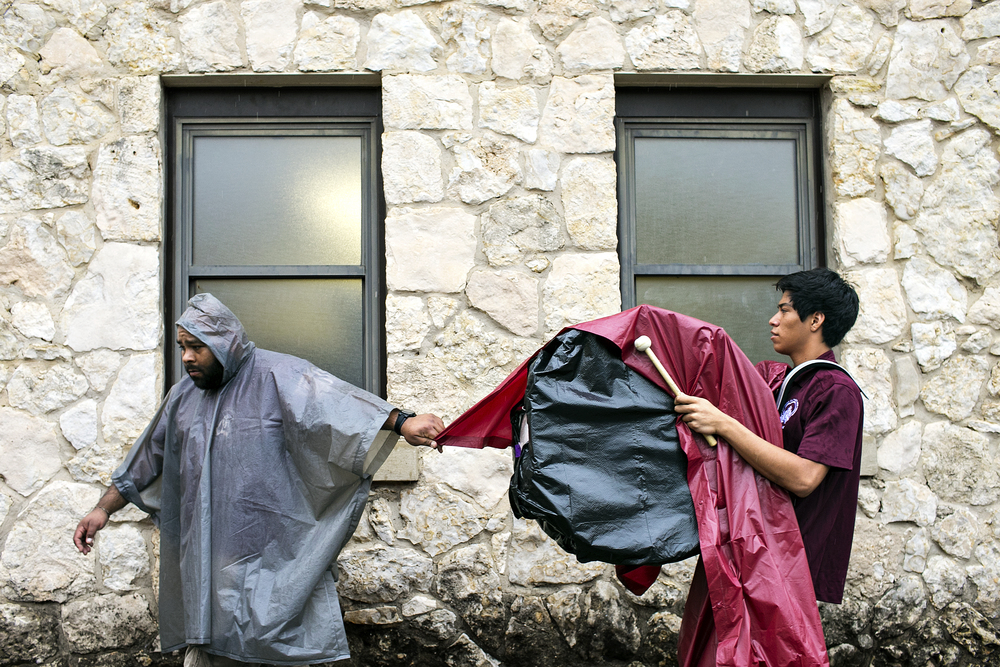 Members of St. Anthony's drumlinewalk to the field enveloped in trash bags and ponchos to guard against the heavy rain in which the Yellow Jackets played their week 5 high school football game against St. Stephen's Episcopal played on September 27, 2014 at Lang Field in San Antonio, Texas. Along with most other private schools in the state, St. Anthony is barred from entering UIL competition, under which most high school football in Texas is organized. Instead, St. Anthony competes under the Texas Association of Private and Parochial Schools (TAAPS) along with over 200 other private schools in the state.