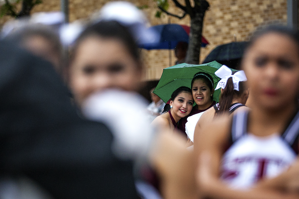 Members of St. Anthony's dance team, the Jacket Jewels, react as St. Anthony's 2014 homecoming court is announced during halftime of the Yellow Jacket's week 5 football game against St. Stephen's Episcopal played on September 27, 2014 at Lang Field in San Antonio, Texas.
