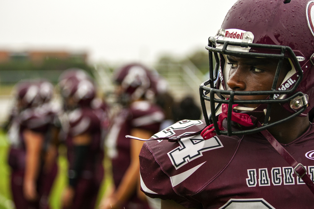 Olan Vining, sophomore wide receiver for St. Anthony, looks on as his teammates warm up prior to the Yellow Jackets' week 5 high school football game against St. Stephen's Episcopal played on September 27, 2014 at Lang Field in San Antonio, Texas.