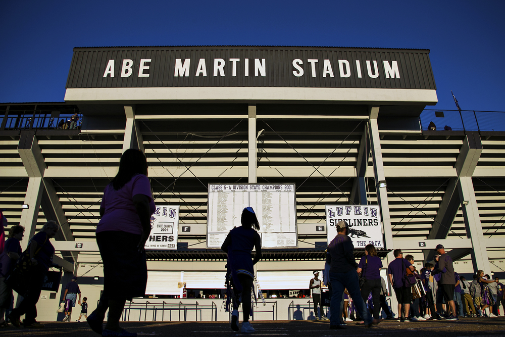 Fans arrive at Abe Martin Stadium, home of the Lufkin High School Panthers, before the Pack's homecoming game against Whitehouse on Oct. 3, 2014 in Lufkin, Texas. Renowned state-wide for its fans and atmosphere as much as for its football team, 41-year-old Abe Martin typically houses over ten thousand football fans during the Panthers' home games.