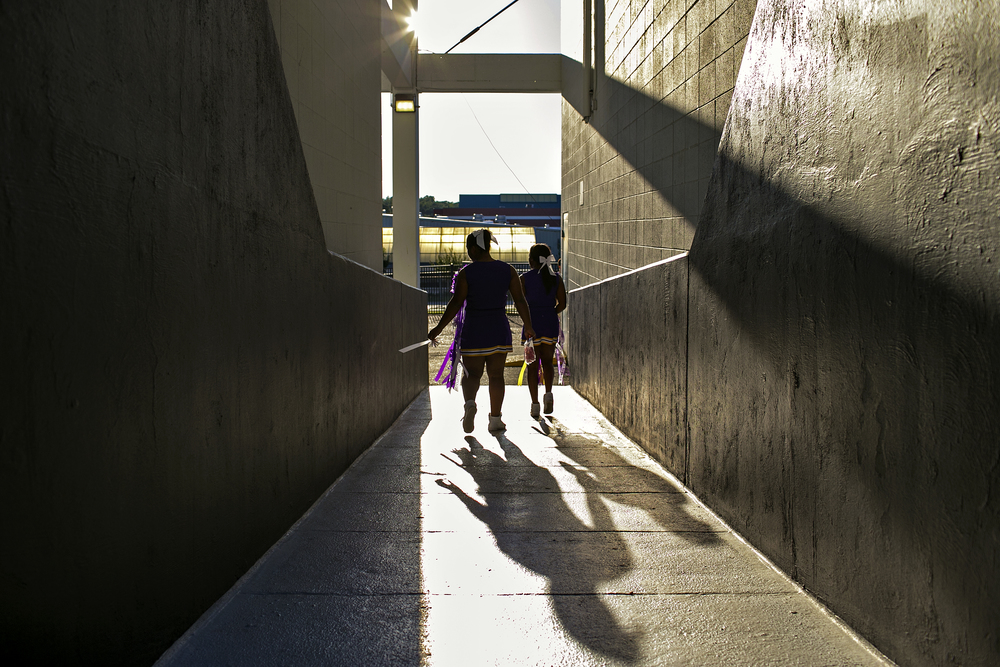 Panther cheerleaders walk through a tunnel in Abe Martin Stadium prior to Lufkin High School's homecoming game against Whitehouse on Oct. 3, 2014 in Lufkin, Texas. Established in 1905, Lufkin High has a proud football tradition dating back to the 1930s and '40s, when head coach Abe Martin led the Panthers to four district championships and only ten losses in seven years. The town's football success was continued by Dunbar High School, the segregated African-American high school in Lufkin, and its conquest of three state championship titles in the 1960's. After Lufkin High's integration in 1970, the Panthers have continuously produced eventual NFL players, including current Dallas Cowboys star Dez Bryant, and were crowned state champions in 2001.