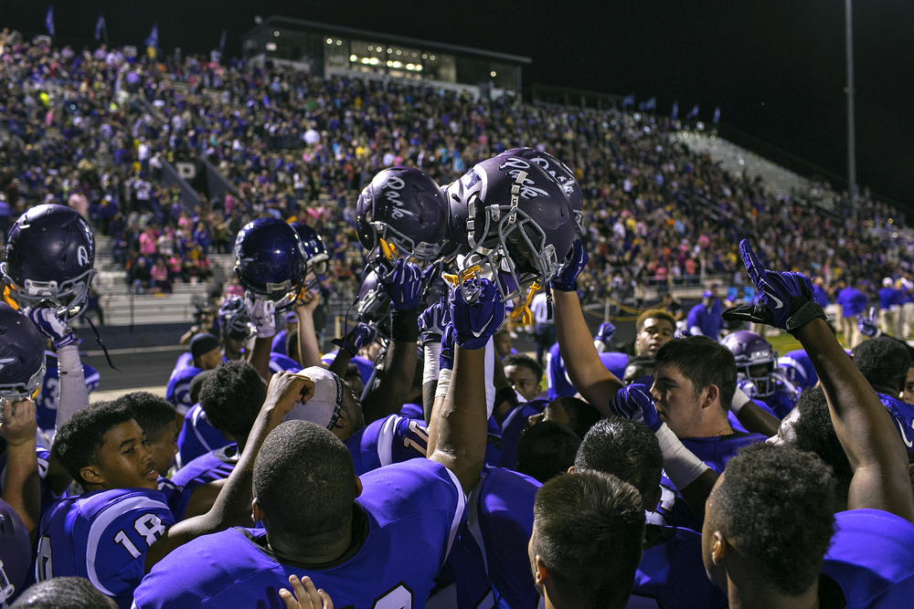 Lufkin High School players huddle before the second half of their homecoming game against Whitehouse played on Oct. 3, 2014 at Abe Martin Stadium in Lufkin, Texas.