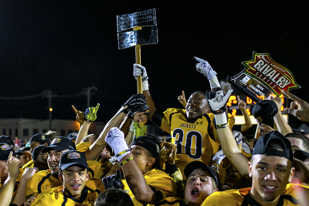 "Yellow Jackets wide receiver Jamale Childs is raised by his teammates as he hoists the Axe after his team defeated Sherman 42-20 in their annual ""Battle of the Axe"" rivalry game played on Oct. 17, 2014 at Munson Stadium in Denison, Texas. While the rivalry has been played for 113 years, the Axe only became a feature after it was donated in 1949 by Jack Barker, a Denison business owner in order to stop vandalism associated with the rivalry. Since then, each game's score is engraved on the blade after the game and the trophy is left in the victor's care until next year's Battle."